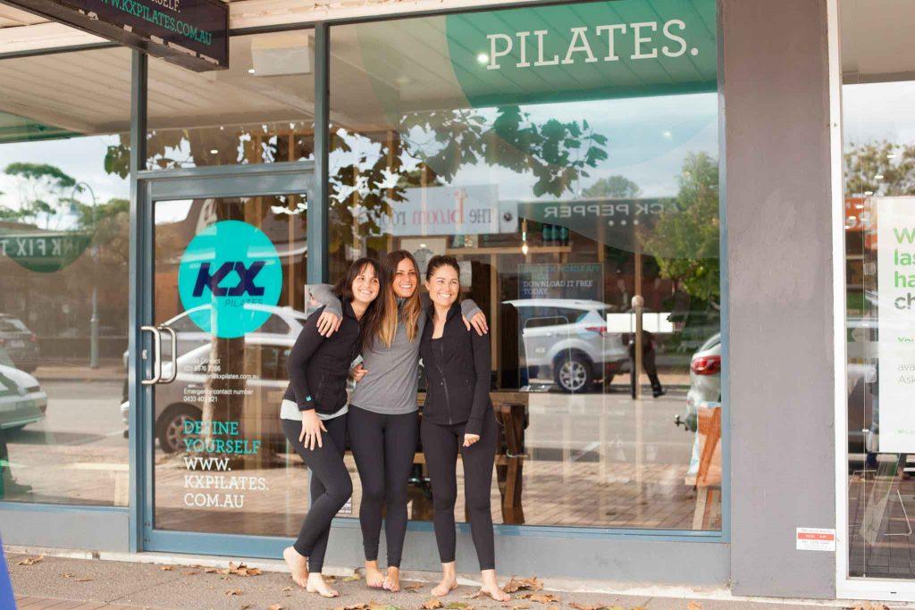 girls outside pilates studio